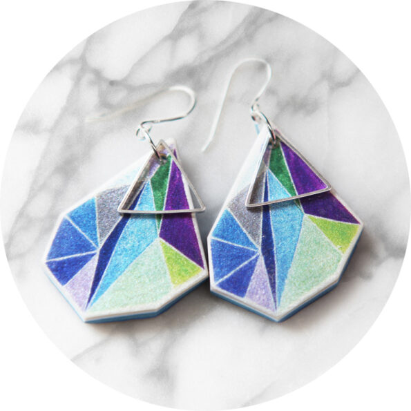 green purple triangle art earrings on marble next romance jewels