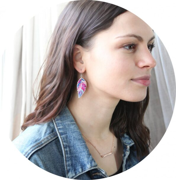 julia-model graphic pink-feather-art-earrings-next-romance