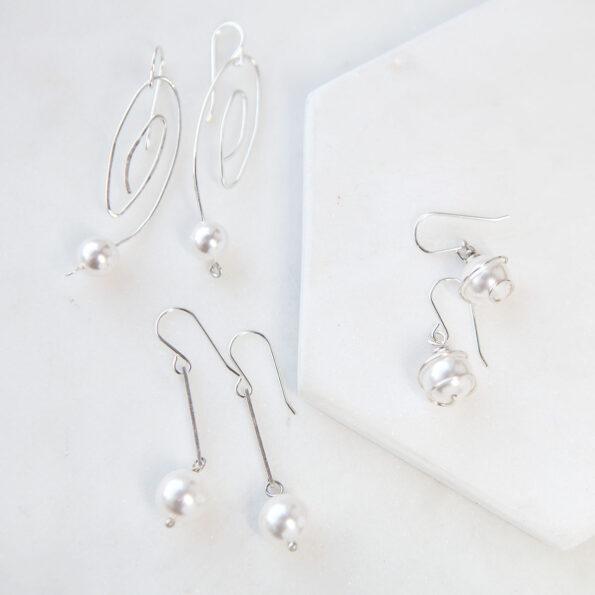 pearl wrapped in sterling silver earrings next romance jewellery handmade original jewellery australia